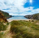 Sunshiny ocean coastline landscape. Sunshiny sandy beach (Spain) Atlantic Ocean coastline landscape Royalty Free Stock Photo