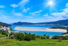 Sunshiny Porto Do Barqueiro, Galicia, Spain. Small harbor and fishing village, Porto do Barqueiro, Galicia, Spain. Summer sunshiny sea coast landscape Royalty Free Stock Images