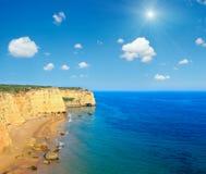 Sunshiny Praia da Afurada Algarve, Portugal. Summer Atlantic rocky coast view with sandy beach Praia da Afurada Lagoa, Algarve, Portugal and blue sunshiny sky Royalty Free Stock Photo