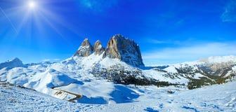 Sunshiny winter mountain panorama. Sunshiny winter mountain landscape with road Sella Pass , Italy Royalty Free Stock Photos