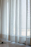 Sunshire light looking pass Translucent white fabric curtains an. D window glass fame and view outdoor background Stock Photo