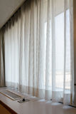 Sunshire light looking pass Translucent white fabric curtains an. D window glass fame and view outdoor background Stock Image