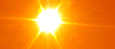 Sunspots. Blazing orange sky with a sun, sun rays and swarming insects Royalty Free Stock Images