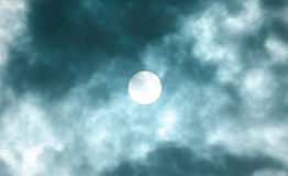 Sunspots. The sun with sunspots shining through clouds Royalty Free Stock Images