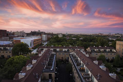 Sunsrise above apartment buildings Stock Photography