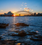 Sunstar at Sydney Opera House, Australia. Sydney, Australia -July 18, 2017: Vertical Panorama in Sydney Harbour with the sun setting right behind Opera House and Stock Photography