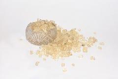 Sunstones in Salt Cellar. Sunstones from Utah spilling out of an old antique crystal salt cellar Stock Photos