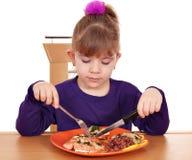 Sunt äta för liten flicka arkivfoto