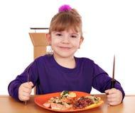 Sunt äta för liten flicka arkivfoton