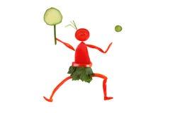 Sunt äta. Liten rolig tennisspelare som göras av peppar. Arkivfoto