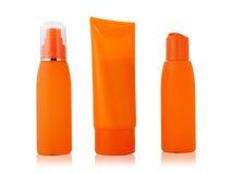 Suntan контейнера 3 апельсинов изолированный на белой предпосылке Стоковые Изображения