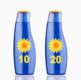 Suntan cream. Blue plastic bottle of sun block cream on white background Royalty Free Stock Image