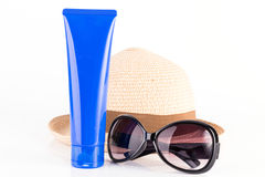 Suntan cream, sunglasses and hat Stock Photos