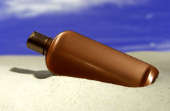 Suntan lotion on beach Royalty Free Stock Photo