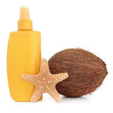 Suntan Lotion. Bottle with coconut and starfish shell over white background Royalty Free Stock Images