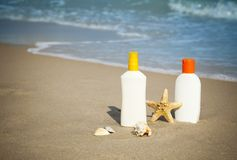 Suntan Lotion Flacons on the Beach with copy space Stock Photo