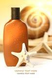 Suntan lotion with seashells stock photos