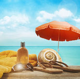 Suntan lotion with towel at the beach Royalty Free Stock Image
