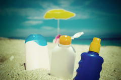 Suntan lotions on the sand Stock Images