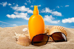 Suntan oil on the beach Royalty Free Stock Image