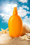 Suntan oil and sea shells Stock Photography