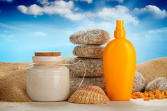 Suntan oil and spa minerals Royalty Free Stock Photography