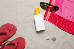 Suntanlotion at the back Royalty Free Stock Photography