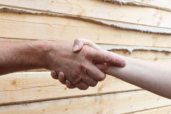 Suntanned male and female hands make handshake. Outdoor Stock Photo