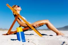 Suntanning babe Stock Image