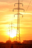 Sunup over electric power line. Bright golden sunrise over electric power lines Stock Image