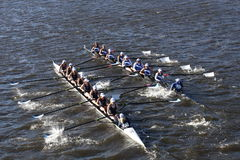 SUNY Geneseo (left) JWU Rowing (right) races in the Head of Charles Regatta Women's Collegiate Eights. BOSTON - OCTOBER 23, 2016: SUNY Geneseo (left) JWU Rowing Stock Image