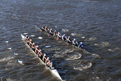 SUNY Geneseo (left) JWU Rowing (right) races in the Head of Charles Regatta Women's Collegiate Eights. BOSTON - OCTOBER 23, 2016: SUNY Geneseo (left) JWU Rowing Royalty Free Stock Image