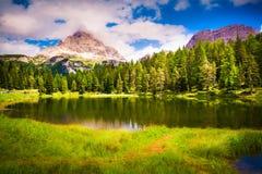 Suny summer scene on lake Antorno. And Tre Cime of Lavaredo south face in Italy Alps, Tre Cime Di Lavaredo, Dolomites, Europe. Soft light filter Royalty Free Stock Photo