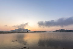 Suoi Vang lake with Langbiang mountains in the morning Stock Images