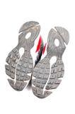 Suole di scarpa usate di sport Fotografia Stock