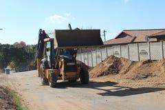 Suolo commovente del caricatore dell'escavatore a cucchiaia rovescia a Durban immagini stock libere da diritti