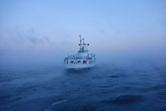 Suomenlinna ferry in the Baltic sea on freezing cold January winter morning Stock Photography