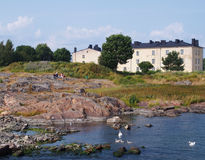Suomenlinna Sea Fortress. Along with exploring the ruins of the old sea fortress, Suomenlinna Island is also a popular place to enjoy a beautiful summer day Royalty Free Stock Photography