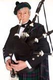 Suonatore di cornamusa in tartan Fotografia Stock