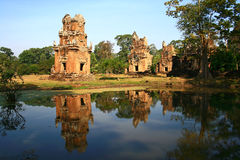 Suor Prat Towers,Cambodia. The northernmost towers,with the khleang behind,Temple beside pool, Angkor,Cambodia Royalty Free Stock Photos