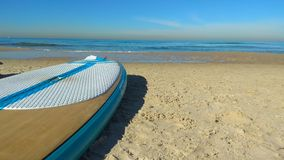 Sup on the beach. Sunny day on the beach with a sup and a calm ocean ahead Stock Photos
