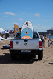 Sup Board lying in the back of a pickup truck on the beach Royalty Free Stock Images