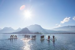 SUP paddling team on the boards. Race on the lake in France stock photo