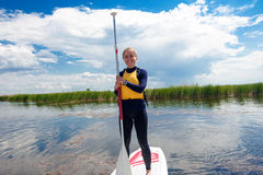 SUP stand up girl with a paddle 05 Stock Images