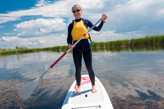 SUP stand up girl with a paddle 04 Royalty Free Stock Images