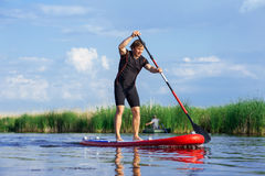 SUP stand up man with a paddle 03 Stock Images