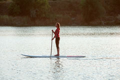 SUP Stand up paddle board woman paddle boarding12 Royalty Free Stock Photos