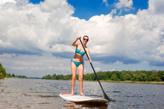 SUP Stand up paddle board woman paddle boarding05 royalty free stock photos