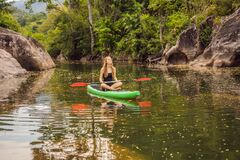 Free SUP Stand Up Paddle Board Woman Paddle Boarding On Lake Standing Happy On Paddleboard On Blue Water. Action Shot Of Royalty Free Stock Images - 176795609