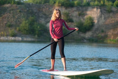 SUP Stand up paddle board woman paddleboarding Royalty Free Stock Image